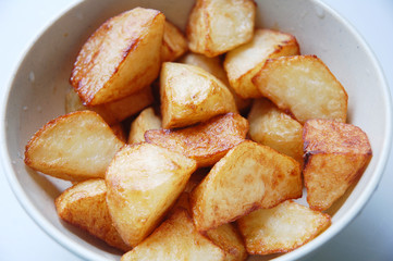 close up of fried potato with white as background