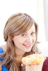 Attractive woman holding a danish pastry