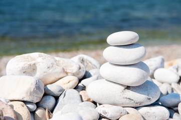 Acrylic Prints Stones in Sand Stacked white pebbles