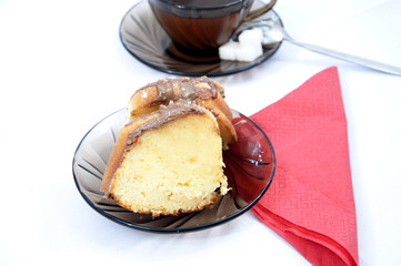 Marble cake on plate with tea