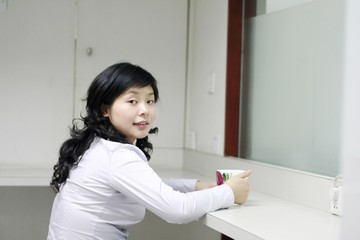 businesswoman with a white cup .
