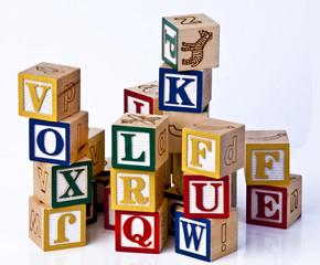 kids learning alphabets blocks