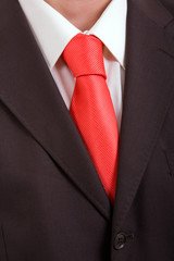 Detail of a Business man Suit with orange tie