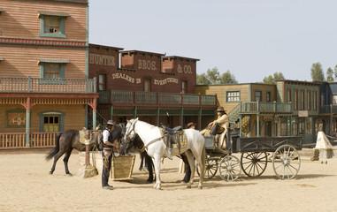 Fototapete - Cowboys watering horses