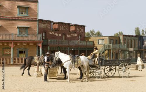 Wall mural Cowboys watering horses