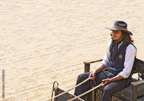 Wall mural Cowboy Sheriff driving a wagon