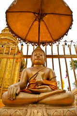 lord buddha and thai umbrella