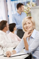 Businesswoman making notes on meeting