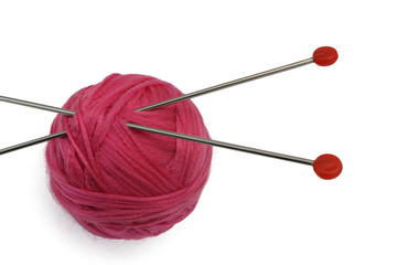 Red clew and knitting needles