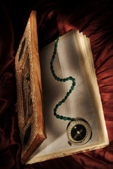 Magic book with wizard  compass