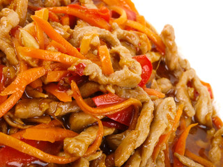 Chinese fried pork meat with pepper and carrot