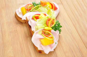 Toaste, canape, bruschette, with tomato, vegetable and ham