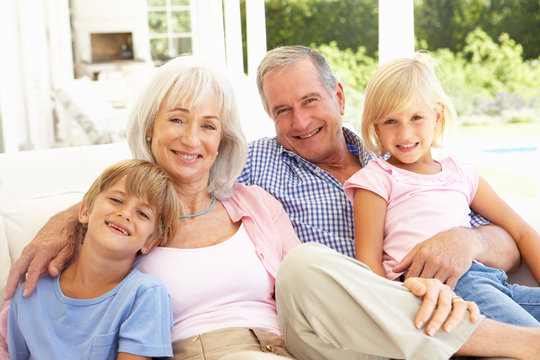 Portrait Of Grandparents With Grandchildren Relaxing Together