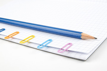 Paper clips and pencil