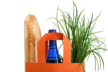 shopping bag with bread, bottle and greenery