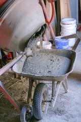 wheelbarrow and fresh cement