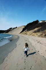 Little Girl running on beautiful beach