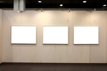 empty frames in a room against a white wall .