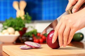 Female chopping food ingredients.