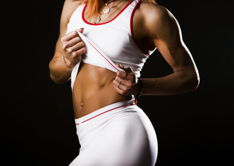 woman showing her abdominal muscles