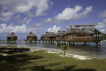 Water bungalow ruins in Huahine. French Polynesia