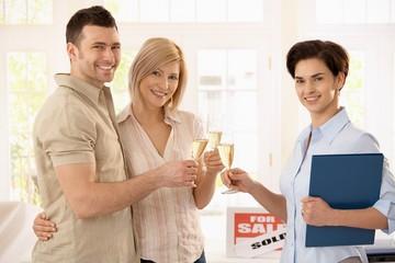 Estate agent congratulating couple