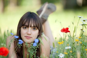 beautiful teen girl posing in flowers