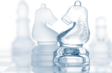 transparent glass chess pieces isolated on white