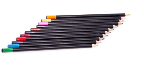 eleven colorful pencils abreast isolated over white