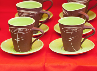 ceramic cups on a red background