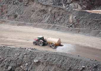 A Quarry Tractor Towing a Dust Suppression Sprayer.