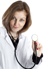 Young nurse with stethoscope in hand on white background