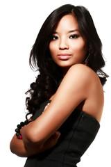 Beautiful young asian model in black dress