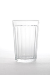 single empty glass isolated on white.