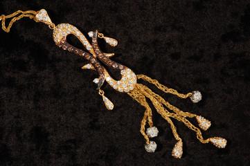 Gold necklace on black bagkround