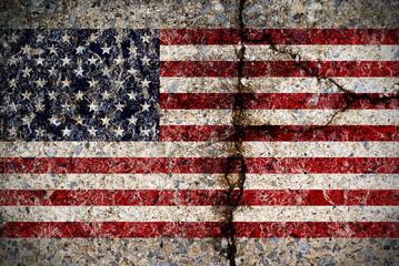 Worn American Flag on Concrete Surface