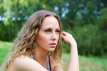 Thoughtful young woman.