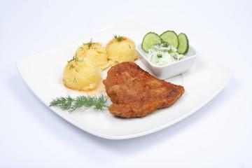 Pork chop, potatoes and cucumber salad