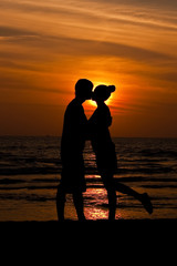 Couple sunset silhouette kiss