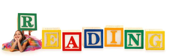 Girl with Alphabet Block Reading