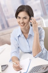 Businesswoman on phone call in office