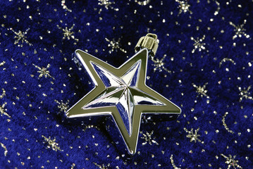 star ornament on blue sky with siver stars pattern