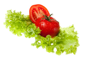 cut tomato on sheet of the salad