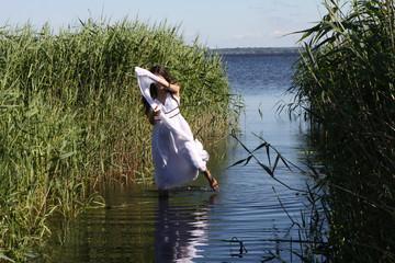Young pregant girl at lake