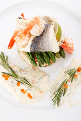 prepared fish with rice and vegetables