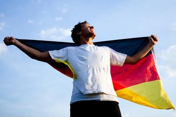 Fußball-Fan mit Flagge