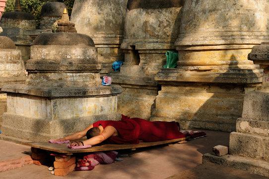 Buddhistic monk prayer. Mahabodhy Temple in Bodhgaya, India.