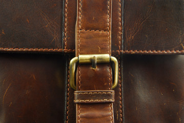 buckle on leather briefcase