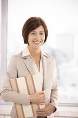 Senior businesswoman smiling in office