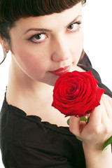 Young woman with red roses